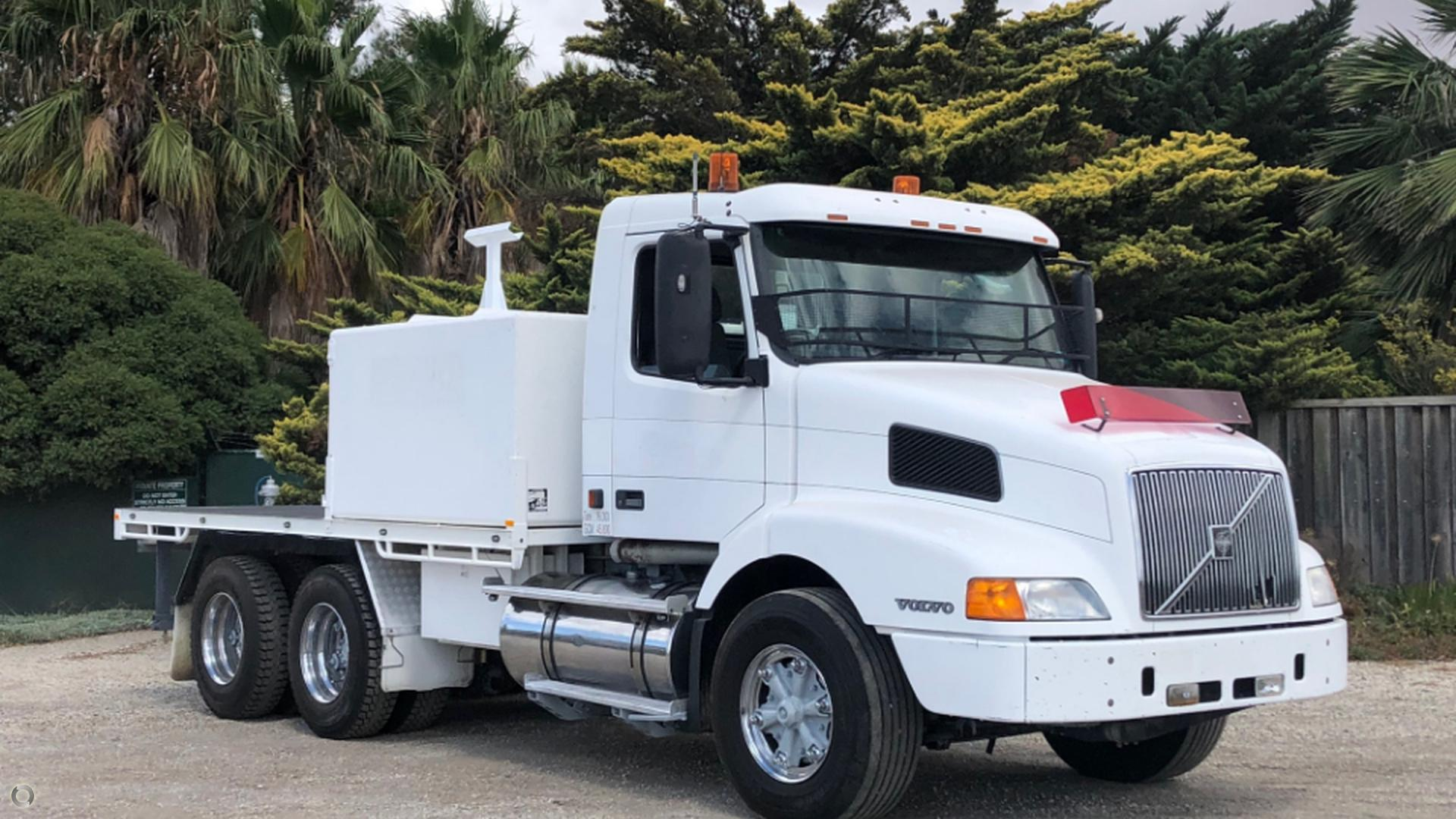1998 Volvo NH12 WATER TRUCK/TRAY TRUCK
